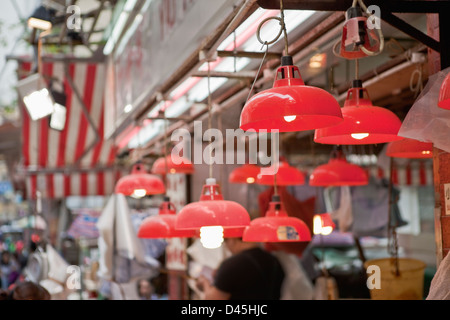 The striking red lamps hanging over shops in Central, Hong Kong's wet market - Stock Photo