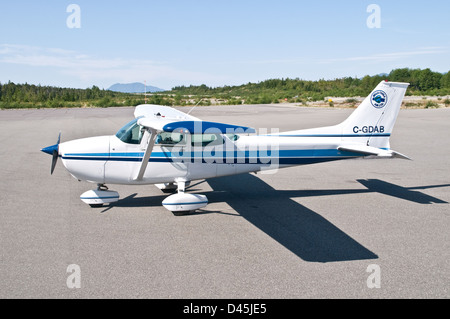 A Cessna 172 airplane parked on the tarmac at Bella Bella airport, in the Great Bear Rainforest, British Columbia, - Stock Photo