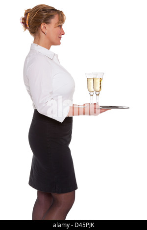 Profile of a waitress holding a silver tray with two glasses of Champagne, isolated on a white background. - Stock Photo