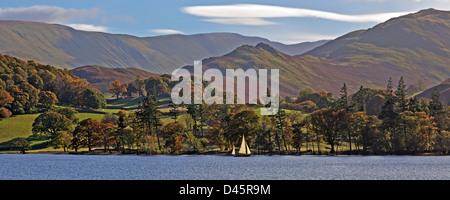 Sailing on Ullswater in the Lake District on a bright sunny Autumnal day with the Cumbrian Mountains in the background. - Stock Photo