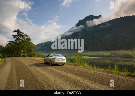 A sedan parked on a dirt road, Silver Lake, Silver Lake Provincial Park, British Columbia, Canada - Stock Photo