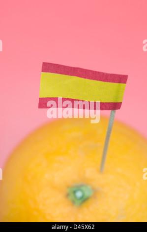 spanish flag on orange fruit - Stock Photo
