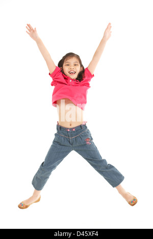 Studio Shot Of Chinese Girl Jumping In Air - Stock Photo