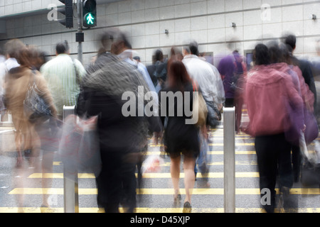 Commuters Crossing Busy Hong Kong Street - Stock Photo