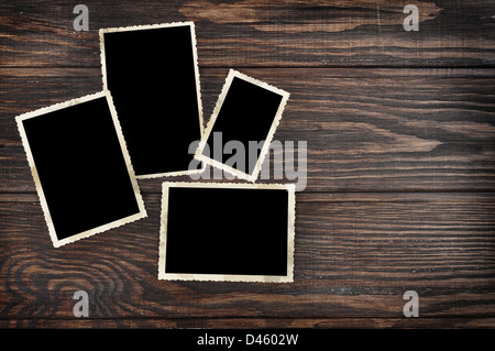 Blank vintage photo frames on old wooden background. Clipping path included. - Stock Photo