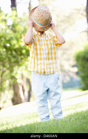 Young Boy Playing In Summer Garden - Stock Photo