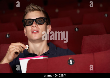 Man Watching 3D Film In Cinema - Stock Photo