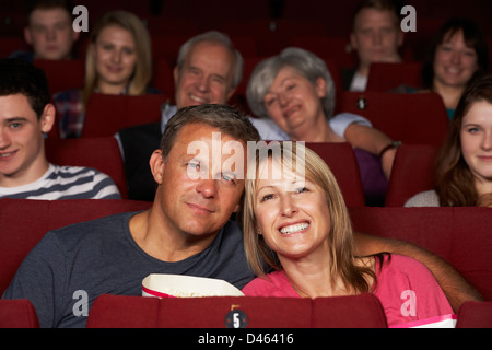 Couple Watching Film In Cinema - Stock Photo