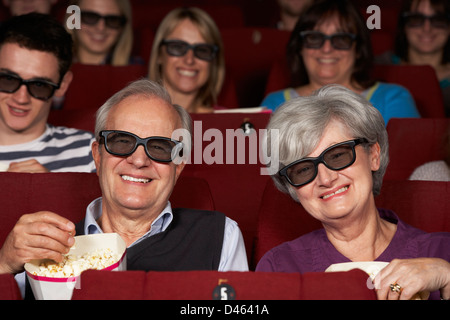 Senior Couple Watching 3D Film In Cinema - Stock Photo