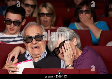 Senior Couple Watching 3D Film In Cinema - Stock Photo