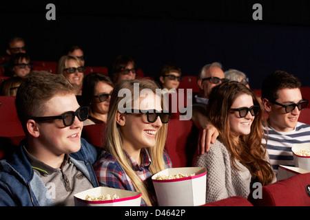Group Of Teenage Friends Watching 3D Film In Cinema - Stock Photo