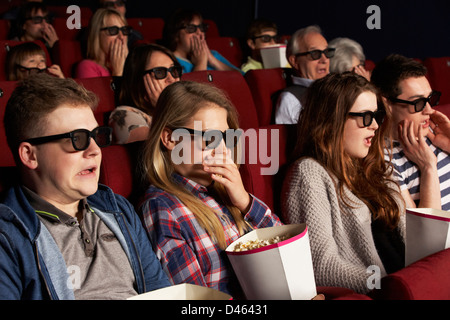 Group Of Teenage Friends Watching 3D Film In Cinema - Stock Photo