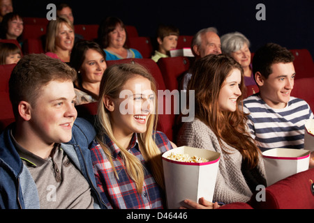 Group Of Teenage Friends Watching Film In Cinema - Stock Photo