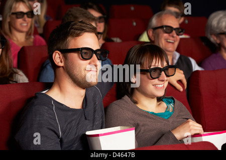 Couple Watching 3D Film In Cinema - Stock Photo