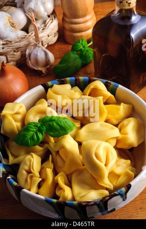 Still life with traditional italian tortellini pasta - Stock Photo
