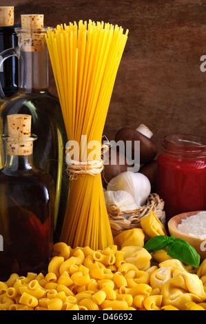 Still life with traditional italian pasta and food ingredients - Stock Photo