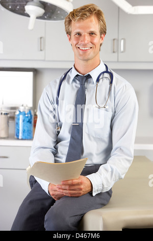 Portrait Of Doctor In Doctor's Office - Stock Photo