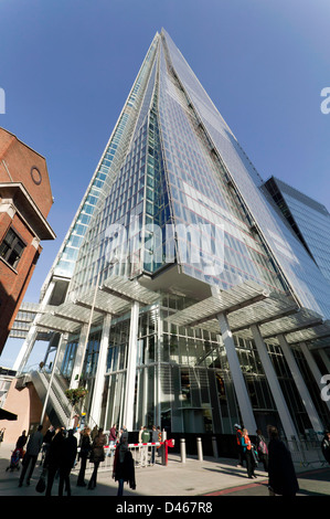Wide-angle view of the Shard from opposite its mian entrance next to London Bridge Station, Southwalk. - Stock Photo