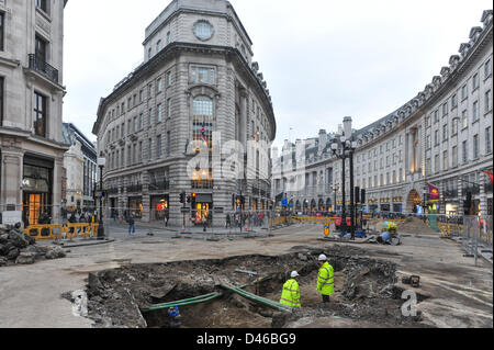 Regent Street, London, UK. 6th March 2013. A large section of the road is exposed as workmen repair the water main - Stock Photo