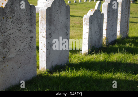 A row of apparently blank headstones in an old Maine cemetery. - Stock Photo