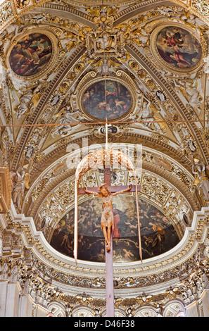 BERGAMO - JANUARY 26: Main apse and cross of cathedral Santa Maria Maggiore on January 26, 2013 in Bergamo, Italy. - Stock Photo