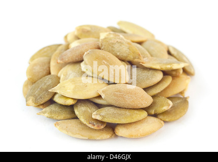 Pumpkin salted seeds on white - Stock Photo