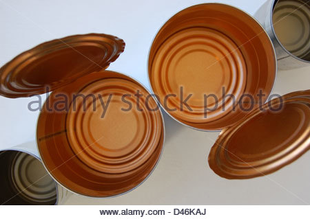 Closeup overhead studio shot natural light assorted metal tins tin cans no labels with lids  showing details of - Stock Photo