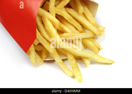 french fries in a red paper wrapper on white - Stock Photo