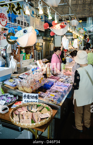 Poisonous fugu (puffer fish) and other seafood on sale at an indoor seafood market in Japan; Japanese fish market; - Stock Photo