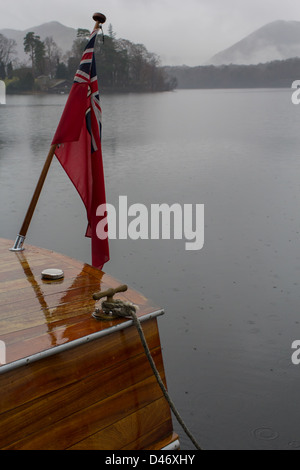 A motor launch tied up alongside a jetty on Derwent Water in the English Lake District National Park - Stock Photo