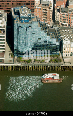 Aerial view of the  Northern & Shell building, a glass-fronted modern office building by the river Thames. - Stock Photo