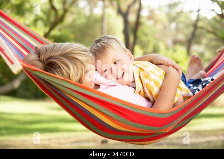 Two Boys Relaxing In Hammock - Stock Photo