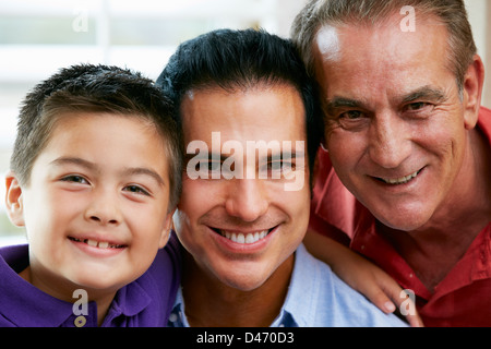 Male Members Of Multi Generation Family Relaxing At Home Together - Stock Photo