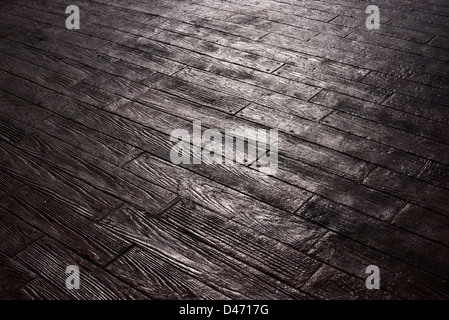 wood-like reflection of the sun on the pavement, background - Stock Photo