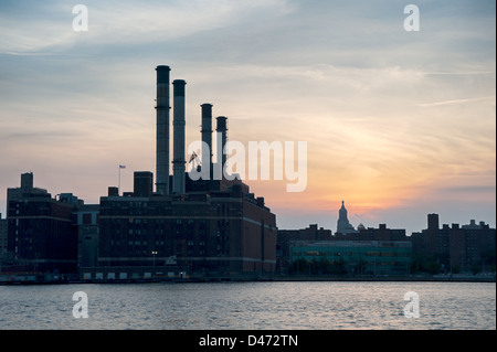 A silhouette of the Con Edison Plant on the East River, Manhattan, New York City. - Stock Photo