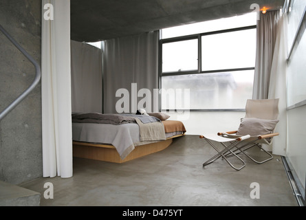 The Mist House, Tokyo, Japan. Architect: TNA, 2012. Bedroom. - Stock Photo