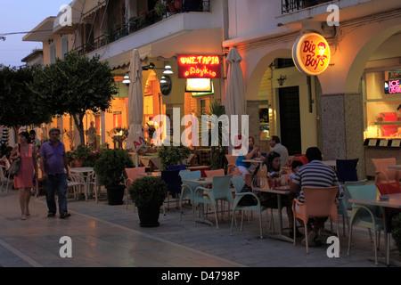 People at the nightime bars in Zakynthos town, Zakynthos island, Greece - Stock Photo