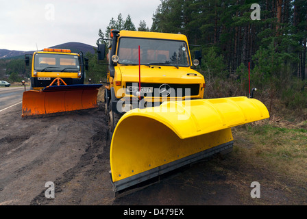 Two snowploughs in Glenmore Forest Park, near Aviemore - Stock Photo