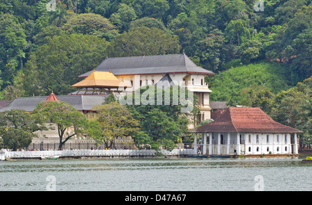 BUDDHIST TEMPLE OF THE TOOTH RELIC IN KANDY SRI LANKA SHOWING THE GOLDEN ROOF - Stock Photo