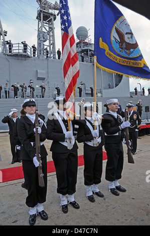 The color guard presents colors during a decommissioning ceremony. - Stock Photo