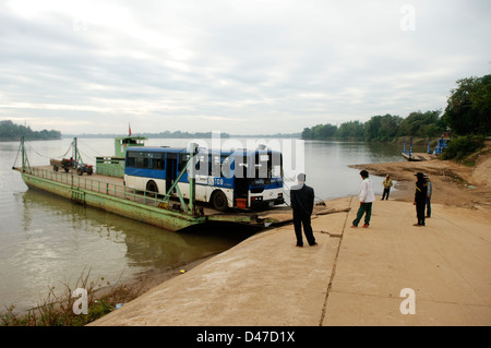 a bus crossing the mekong river by ferry, don khong, laos - Stock Photo