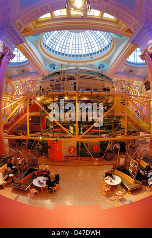 Interior of the Royal Exchange Building in Manchester showing the theatre in the centre. - Stock Photo