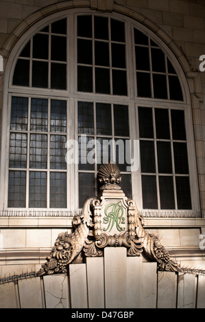 Keystone and cornucopian devices to left and right inscribed 'MR' and '1912' at entrance to Baker Street tube station, - Stock Photo