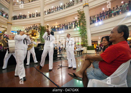 Members of the U.S. 7th Fleet Band, Far East Edition Brass Band, perform for more than 3,100 people at Robinsons - Stock Photo