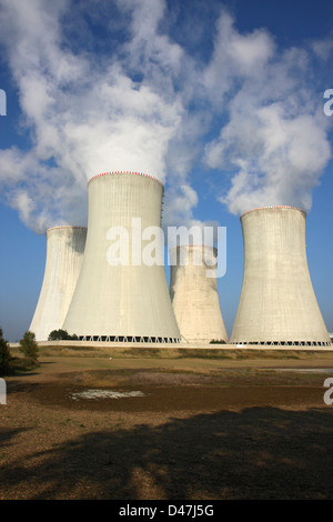detail of four cooling towers of nuclear power plant - Stock Photo