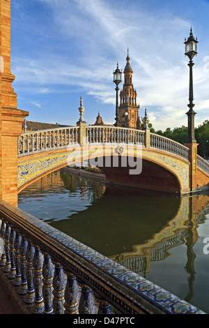 Tower and bridge over canal, Plaza de Espana, Seville, Spain - Stock Photo