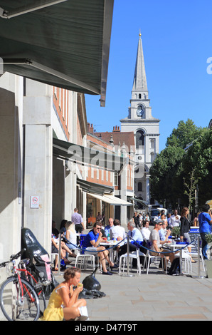 Busy cafes at lunchtime in summer on Brushfield Street next to Old Spitalfields Market, London E1 - Stock Photo