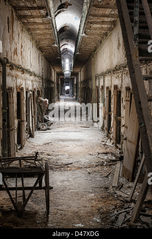 Prison cell block in abandoned bad condition, empty and old, Eastern State Penitentiary, Philadelphia, PA, USA. - Stock Photo