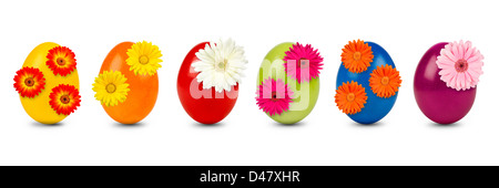 row auf colorful easter eggs decorated with gerbera blossoms - Stock Photo