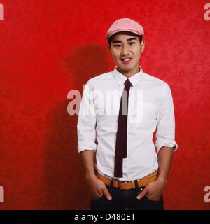 d41bd4881a0 ... Portrait of a fashionable Japanese young man in vibrant colors. - Stock  Photo